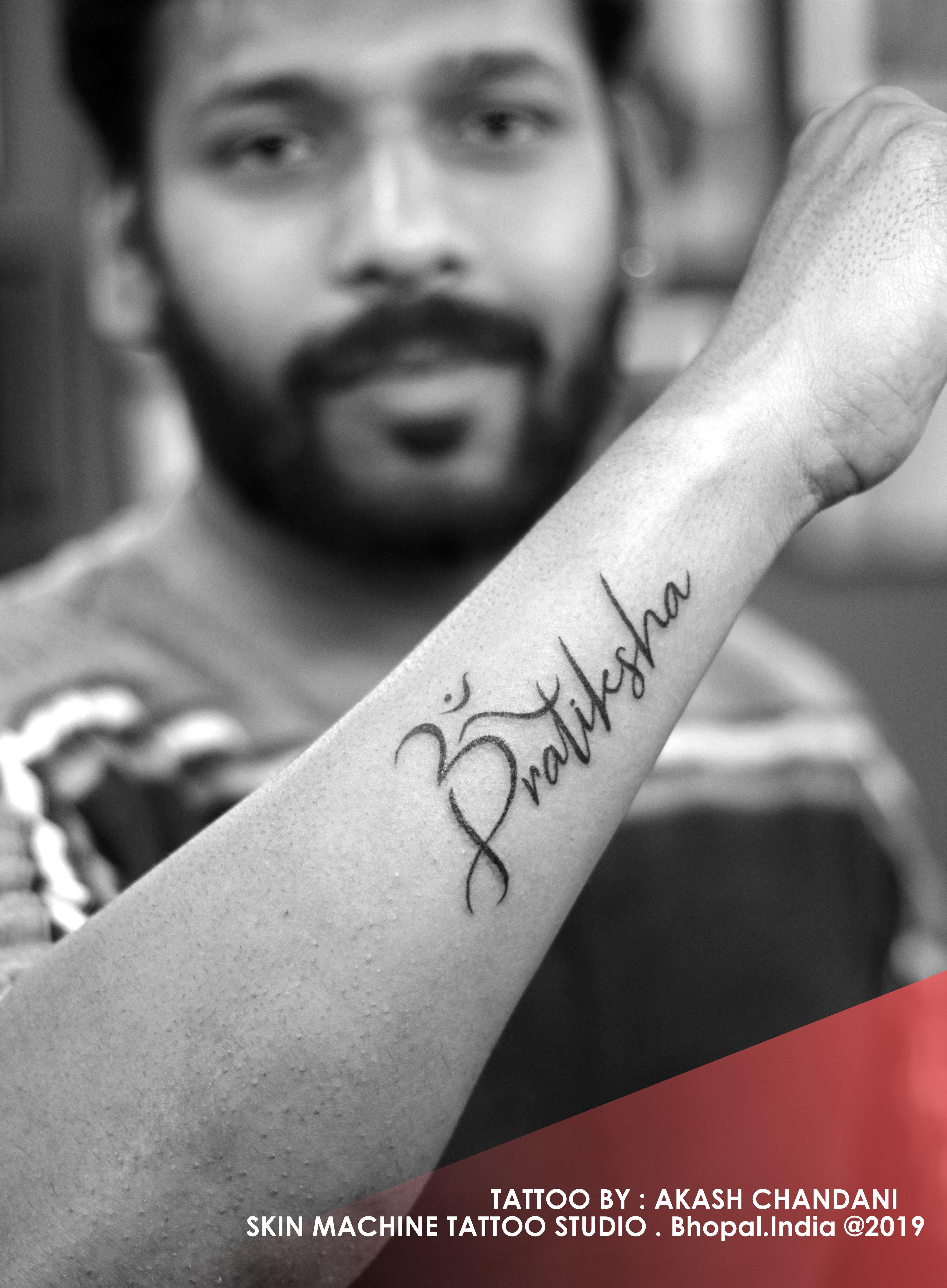 Om With Name Pratiksha Designed By Akash Chandani Skin Machine Tattoo Studio Email For Appointmen Name Tattoo Designs Om Tattoo Design Name Tattoos On Wrist