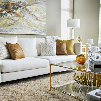 Contemporary Living Room With White Modern Sofa, Copper Pillows, Gold  Accents