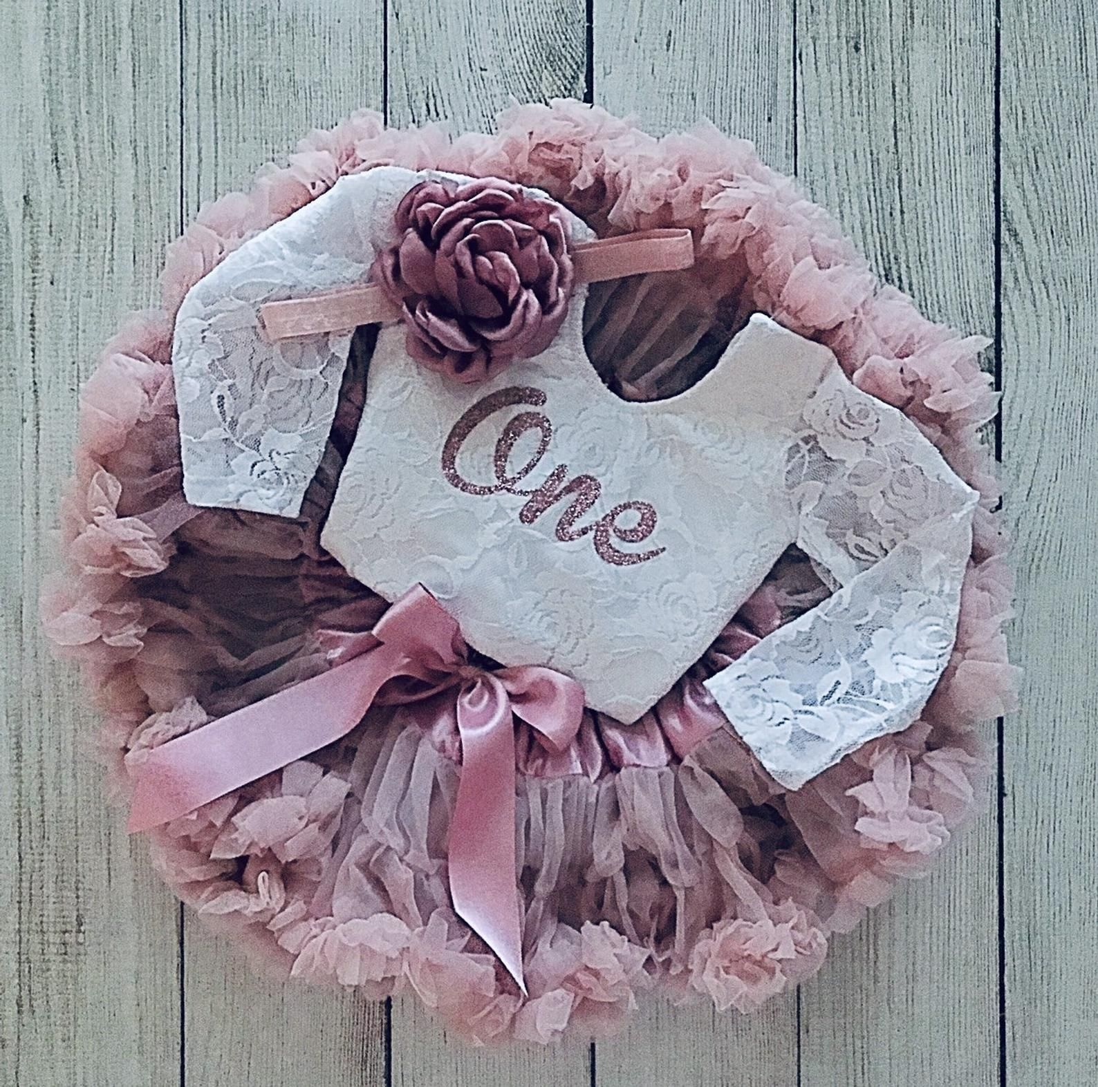 Baby girl first birthday outfit in dusty pink vintage