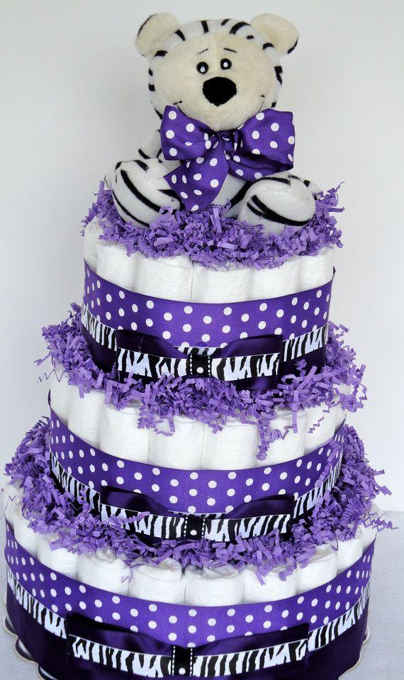 Diaper Cake - Purple & Black Zebra Baby Girl Shower Diaper Cake Centerpiece - 3 Tier. $80.00, via Etsy.