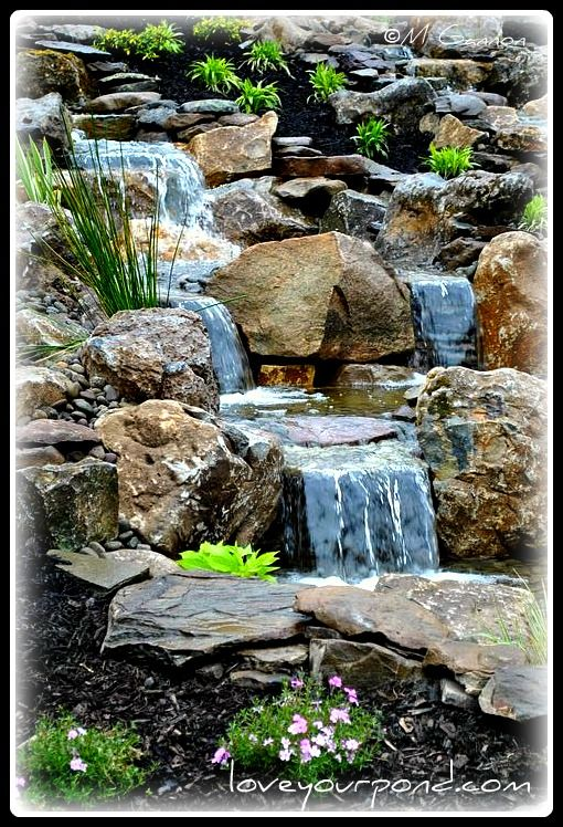 Backyard slope waterfall display designed and installed by ...
