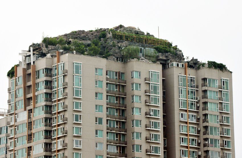 In Beijing, an eccentric resident has attracted the ire of his neighbors with the elaborate rock-like structures he has built to surround his rooftop home. The illegal landscape, consisting of false stone and real plants, has neighbors in the 26-story building worried about the possibility of collapsing ceilings.
