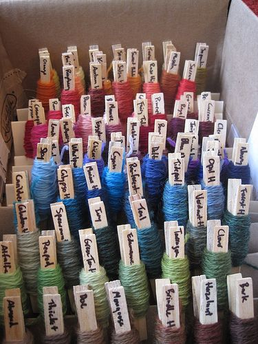 clothespins wrapped with yarn make a color palette selection tool for knitting, crochet, or embroidery