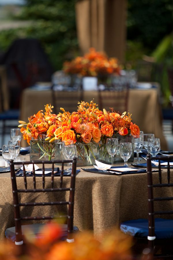 Orange and blue southern rehearsal dinner centerpieces