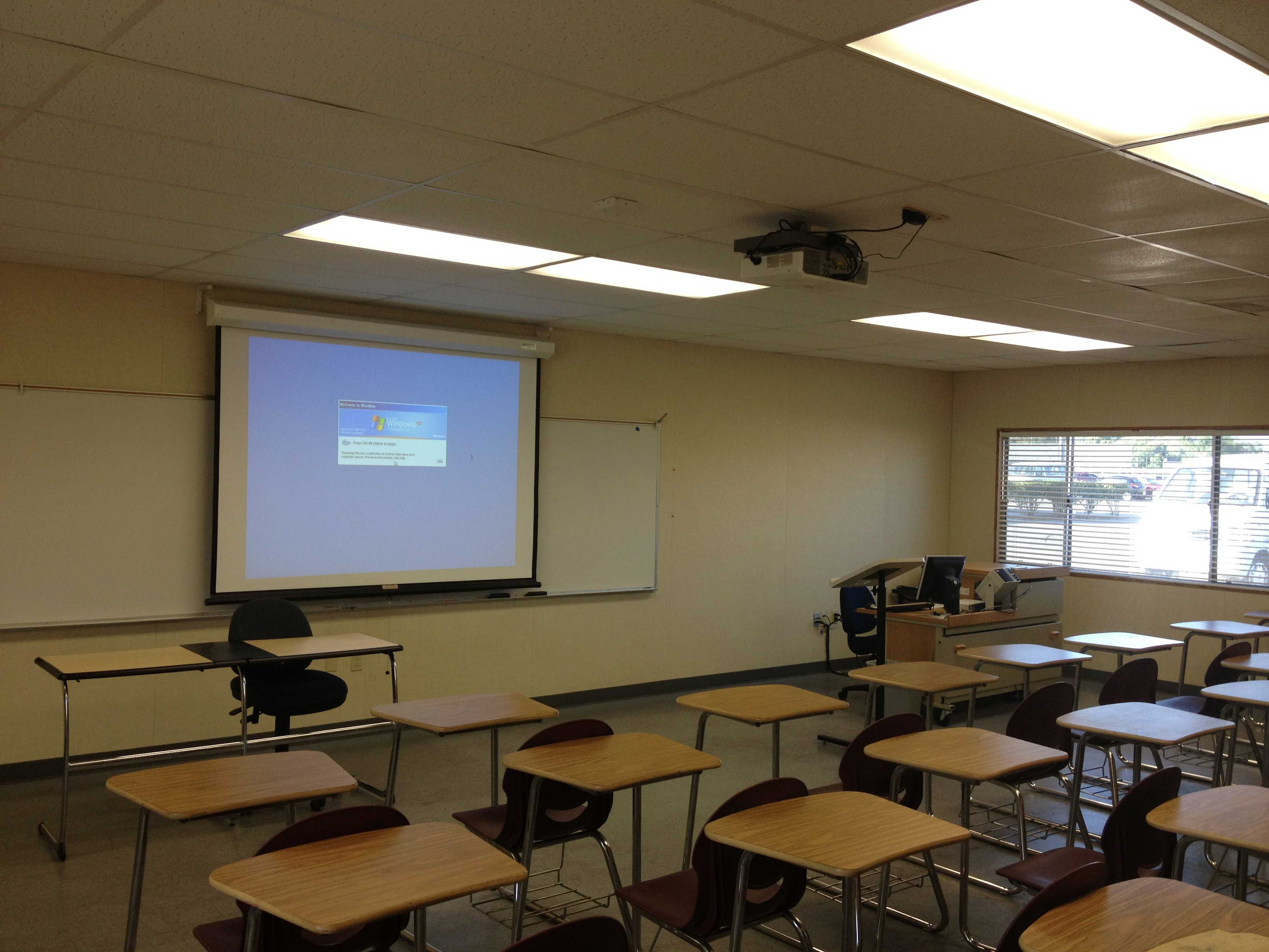 A Hitachi Classroom Series Projector Mounted To The