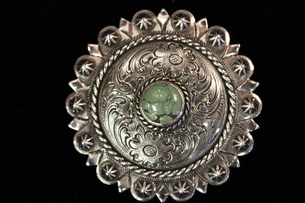 Sterling round buckle from the Custom Cowboy Shoip