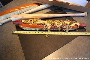 """Texas Rangers starts selling """"Champion Dog"""" at Rangers Ballpark. 2-foot-long mega hot dog at $26."""