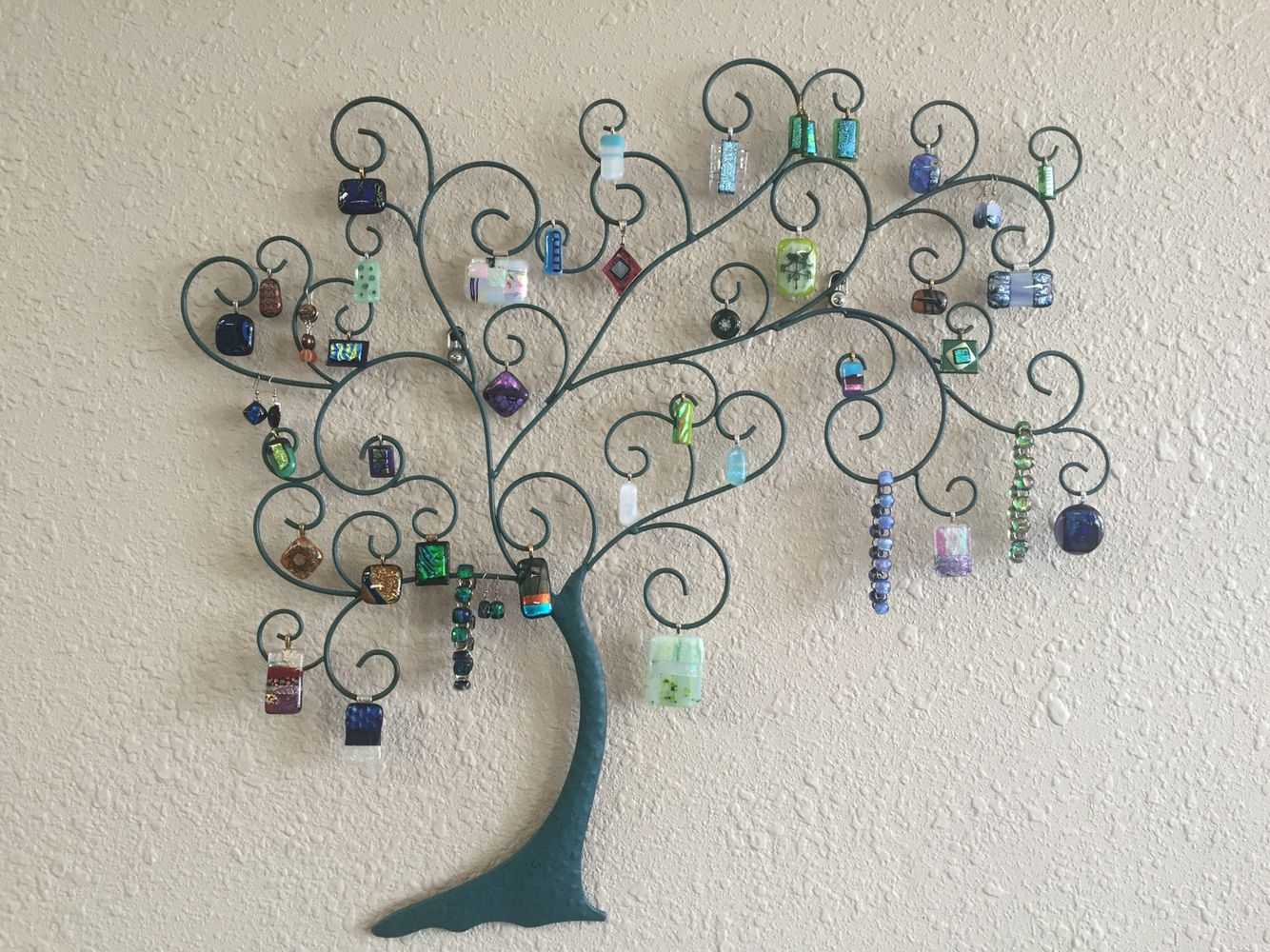 My jewelry hanging on a metal tree on the wall.  Turned out well!