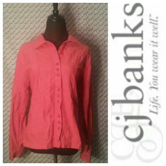 Red Button-Down Top This red top is perfect for cold winter days! Made of thick fabric, this top is a great addition to your closet this winter. Features include long sleeves, buttons and a frilly detail near the bottom of the back of the shirt (see pic three). Great condition! C. J. Banks Tops Button Down Shirts