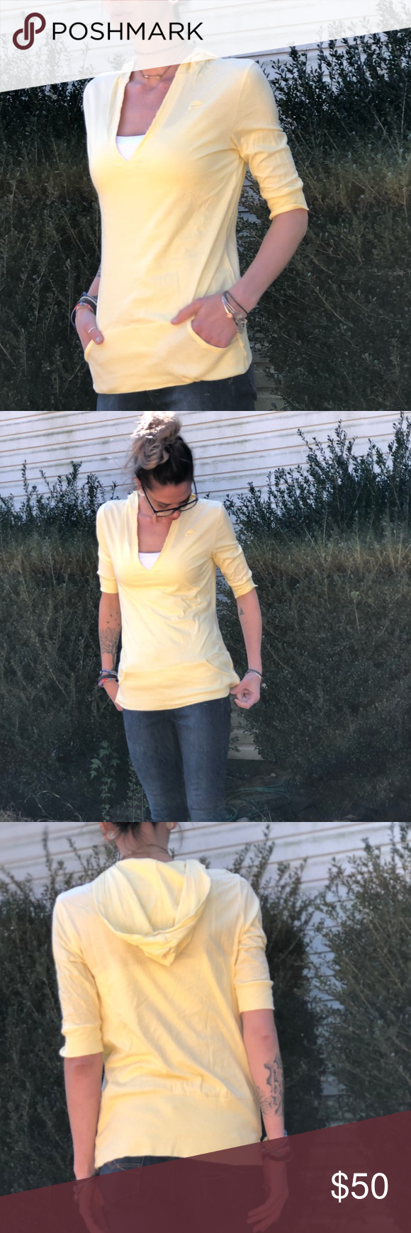 Light yellow 3 quarter length sleeved, with hoodie This lightweight thin hoodie-like top is great for just about any season! With the Nike logo on the top left chest. Tiny pockets on the bottom band. Only worn a time or two!! Nike Tops #niketops