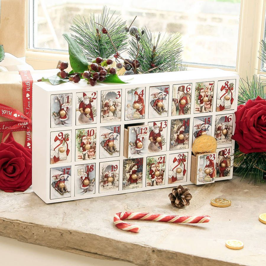 Santa claus large wooden advent calendartraditional in design this large rectangular advent calendar is a fantastic durable alternative to the cardboard