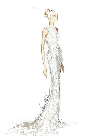 The ivory crystal beaded and embroidered Chantilly lace halter gown by Carmen…