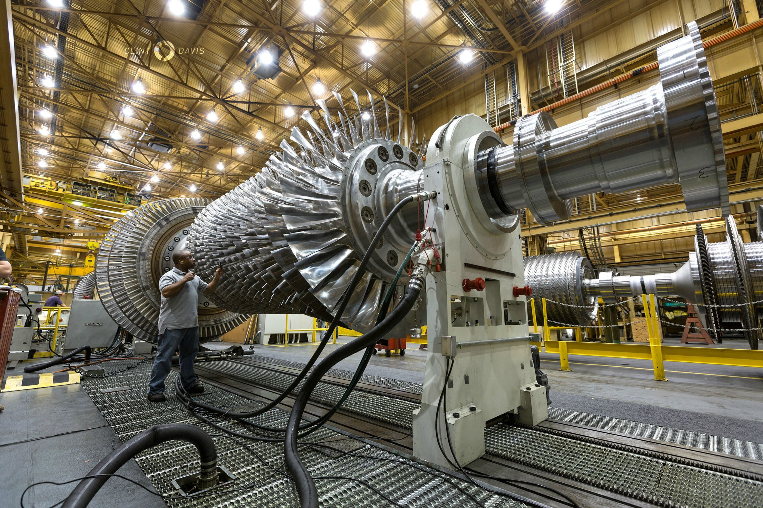GE worker inspecting F class gas turbine in Greenville SC