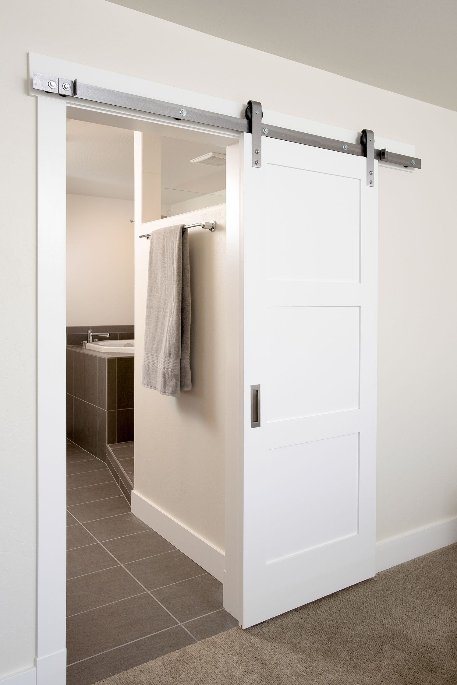 This Contemporary Sliding Interior Barn Door Blends Seamlessly With
