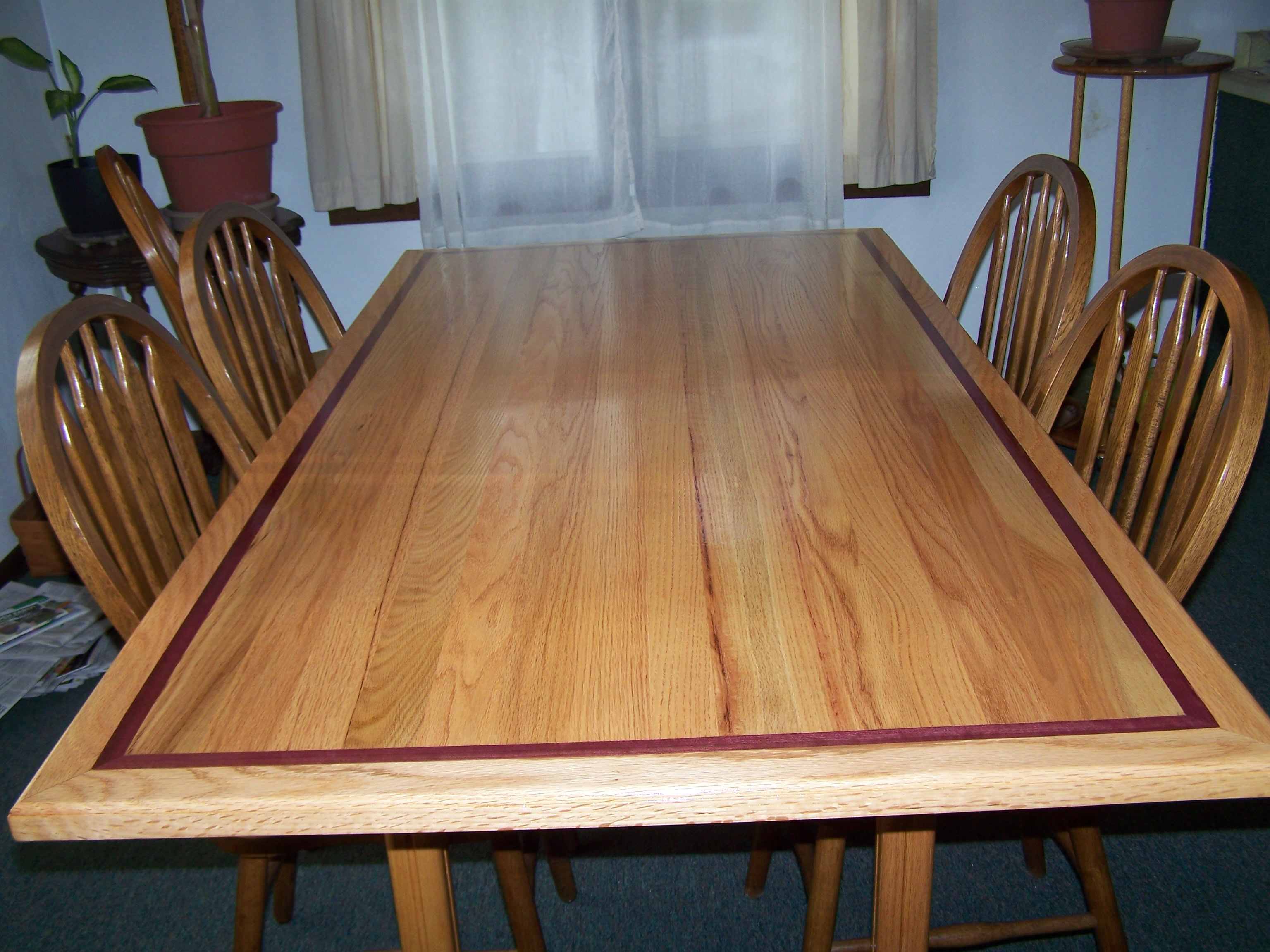 Dinningroom table with purple heart wood inlay... Not