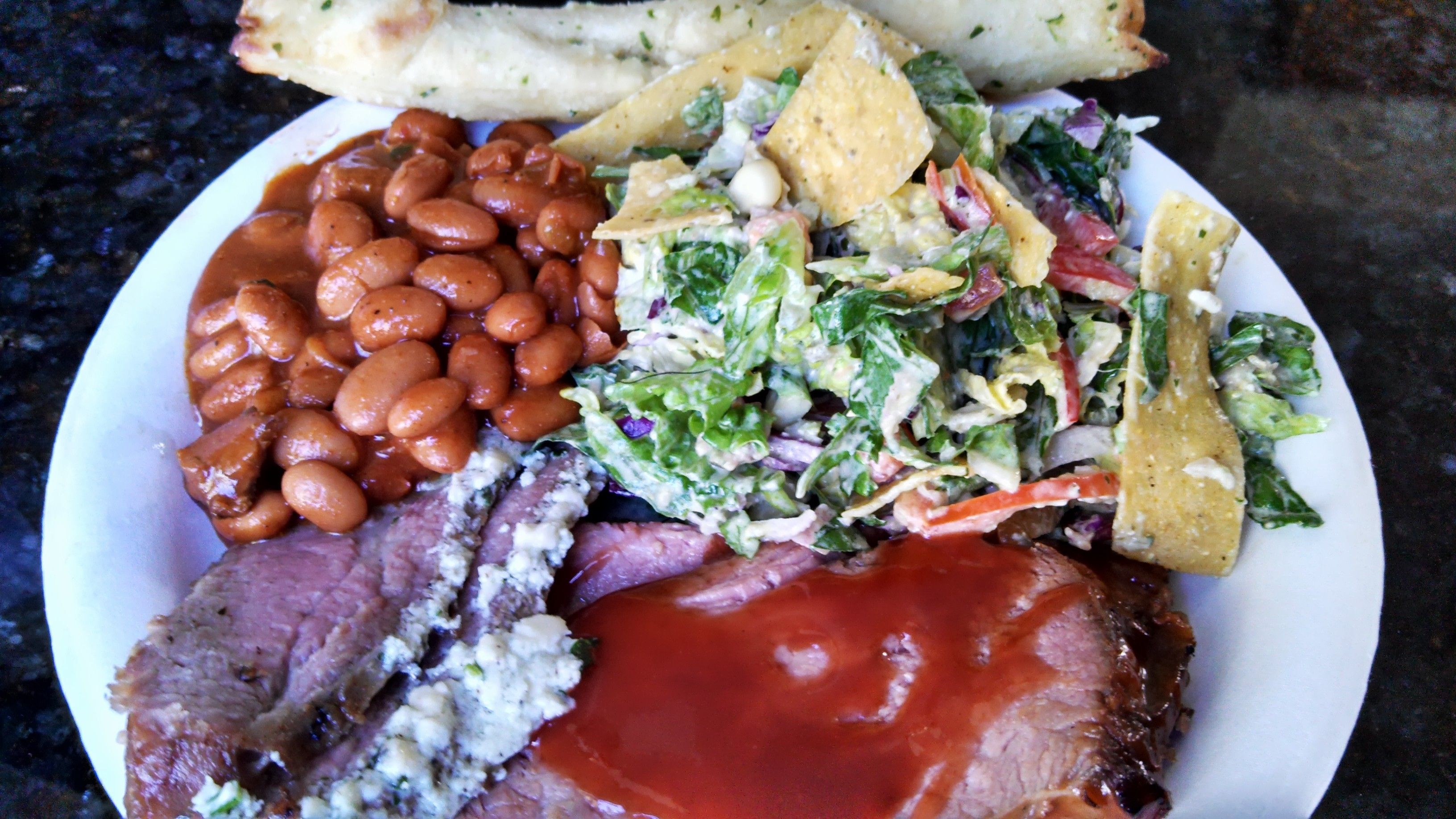 A Plate Of Crowd Pleasers From Stonefire Grill Tri Tip Two Ways Cowboy Beans South Of The Border Salad And A Breadstick Cowboy Beans Food Eat
