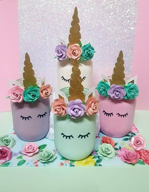 Unicorn Mason Jar, Unicorn Party Decor, Unicorn Decor, Unicorn, Glitter Jar, Pastel Unicorn, Home Decor, Pencil holder, Unicorn Mason Jars - Unicorn decorations, Unicorn party decorations, Unicorn and glitter, Mason jar crafts, Jar crafts, Mason jar crafts diy - Unicorn Mason Jars Glitter!!!! ✔✔✔ Looking for a unique Christmas gift  One or a set of these will be a magical suprise!  Unicorns and glitter oh my!! Having a unicorn birthday party   You can't go wrong with these adorable pint size unicorn mason jars     with glitter! The pictures just do not capture the sparkle! These jars are coated with iridescent glitter   We can customize the flowers to match your decor  Use these as a fun way to hold your party utensils, add flowers, cake pops, your options are endless!  These also make cute accents to your little girls bedroom or bathroom decor  They can hold markers, pens, rulers, ponytail holders, tooth brushes, you name it!  Jars are painted with chalk paints, pictured are pastel colors but look a little darker in the pic  Jars are coated in iridescent glitter and decorated with paper flowers, ears made of glitter felt and material, horn made of double sided glitter cardstock  Eyelashes are done permanent vinyl  If you'd like a different eyelash style just let us know, we'd be happy to change them   Flower colors and jar colors are completely customizable  Just let us know the colors you'd like in the  note to seller  section of your order   Size Pint jars measure 8 25  tall (including horn) Quart Jars measure 10 75  tall (including horn)  Please note If you would like flowers to match your particular decor please let us know in the  note to seller  section of your order   📌📌📌📌The current time it takes us to prepare your order for shipping is approximately 3 weeks  If you need your order before then please contact us prior to ordering  I'd be more than happy to try and accommodate your time frame 😊 Please feel free to contact us anytime with any questions you may have