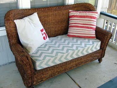 re-stained wicker loveseat with handmade painted cushion cover and pillows