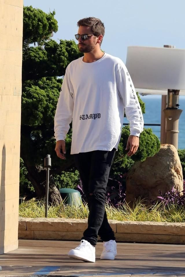 Scott Disick is dressed in Nike AirForce sneakers and white