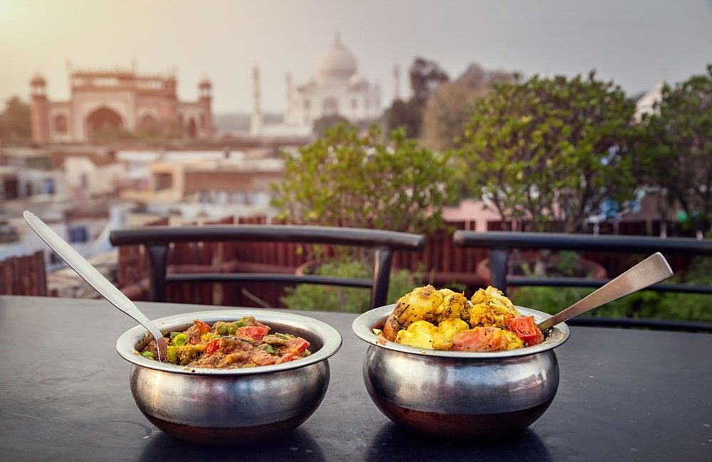 Traditional indian food in metal dish on rooftop restaurant with taj traditional indian food in metal dish on rooftop forumfinder Image collections