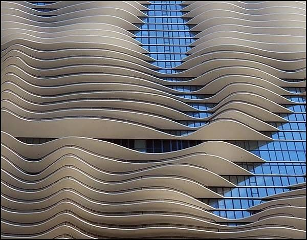New Water Tower (Aqua Tower) - Chicago IL.  Its height of 250 meters, is a unique sculptural facade of a building, creating the illusion of waves.