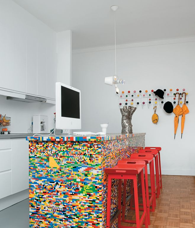 The idea for Simon Pillard and Philippe Rossetti's Lego kitchen in Paris sprouted five years ago, when Pillard put 500 blocks and a day's worth of work into building a Lego-legged chair. The designing duo—who create products together under the name Munchausen—recently gave the seat a colorful companion. They covered their kitchen island—a simple wooden block—with 20,000 Lego pieces.