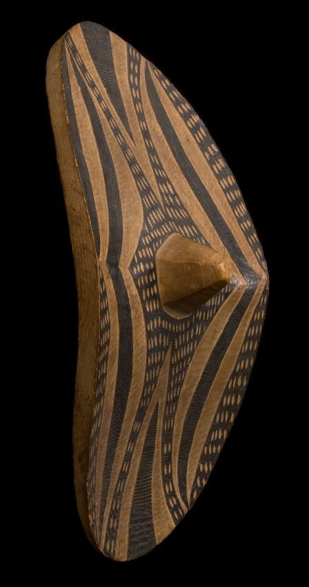 Africa | Tutsi Ceremonial Dance Shield  Rwanda | Early 20th century | Wood and natural black dye  ~ The entire shield was painted or dyed in black, then a thin layer of surface was removed to create the design.