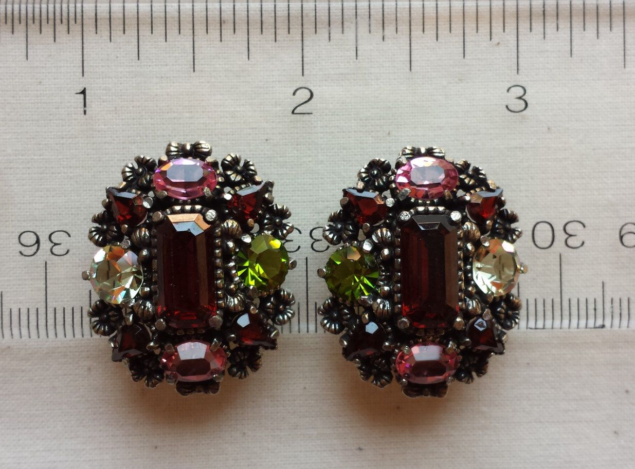 Hollycraft multicolor faceted rhinestone oval shape earrings, central baguette in deep ruby red color, by marnystreasures on Etsy https://www.etsy.com/listing/194861929/hollycraft-multicolor-faceted-rhinestone