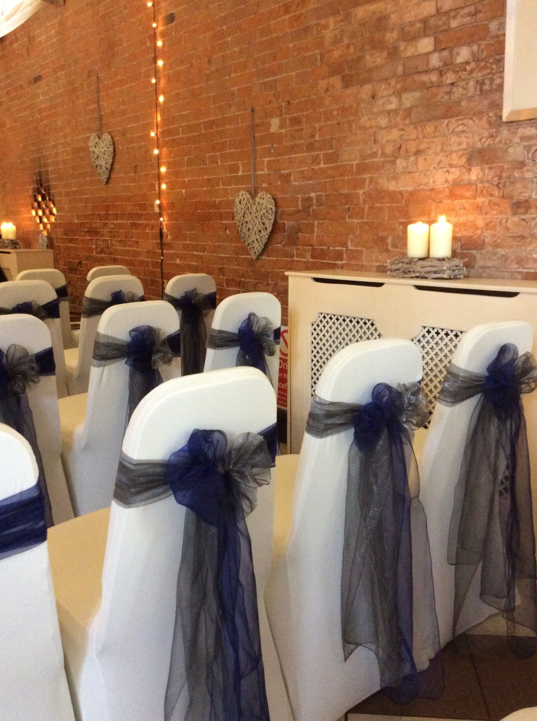 Silver Chair Covers Uk Modern White Dining And Navy Sashes Tied In A Rosette For Winter Inspired Wedding Www Beautifulvenuedecor Co