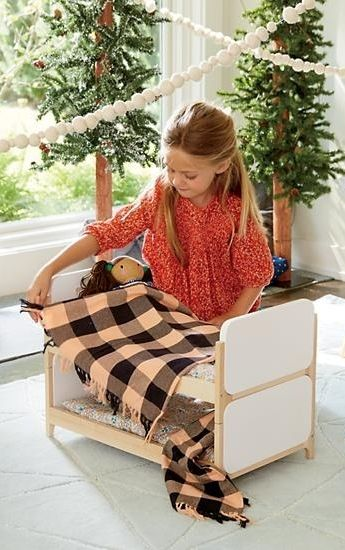 Looking for cozy doll furniture? Well, look no further. Our Mod Doll bed is scaled down for your kid's dolls and designed exclusively for us by Royce Nelson.