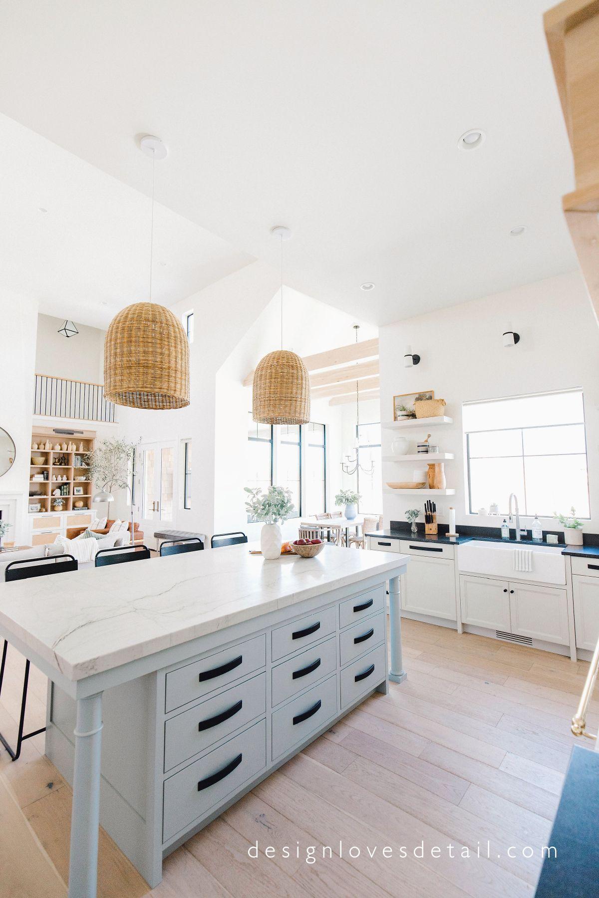 Light gray blue kitchen island with black