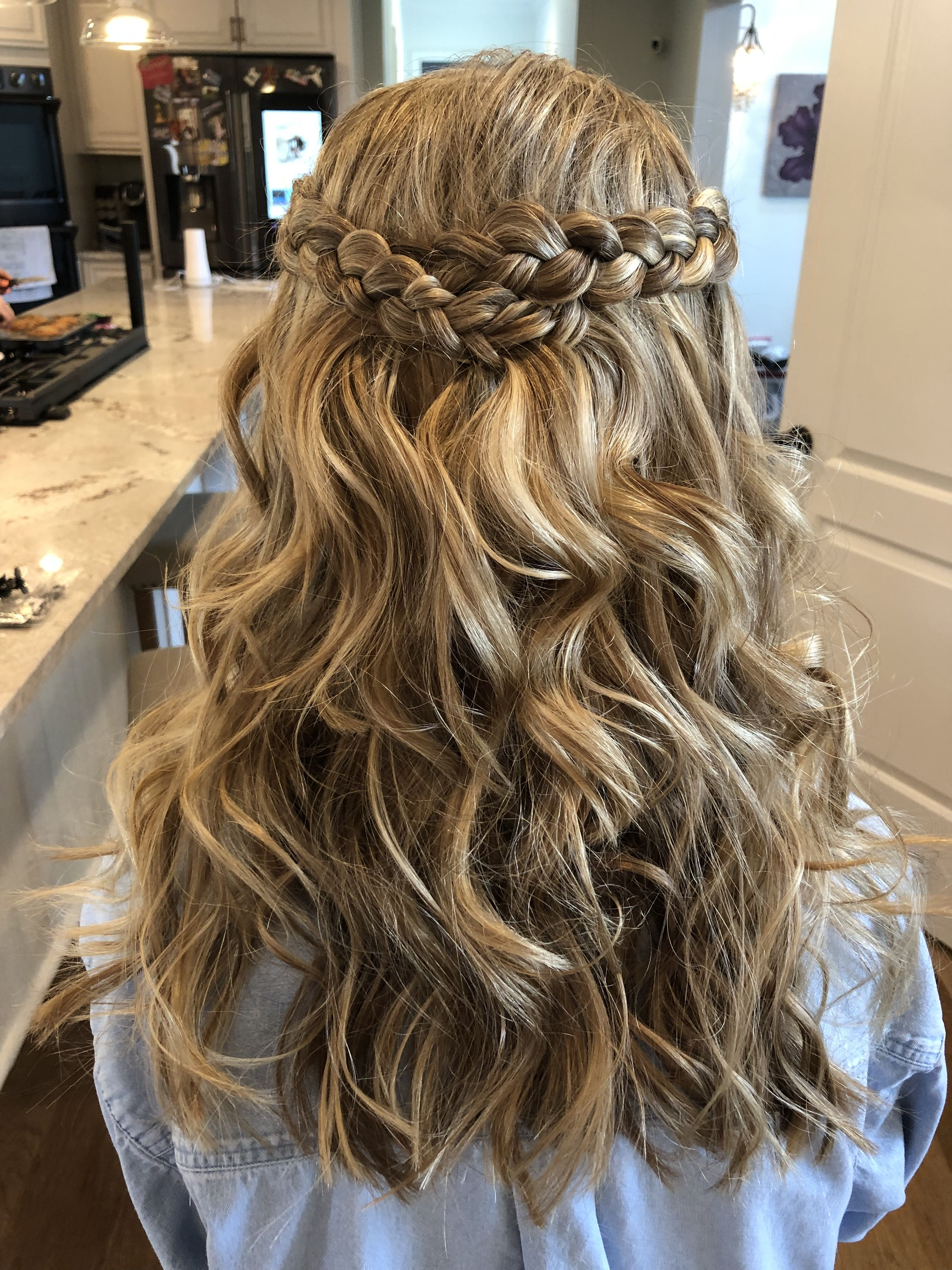 Medium length hair curled with 12inch wand. Braided sides brought