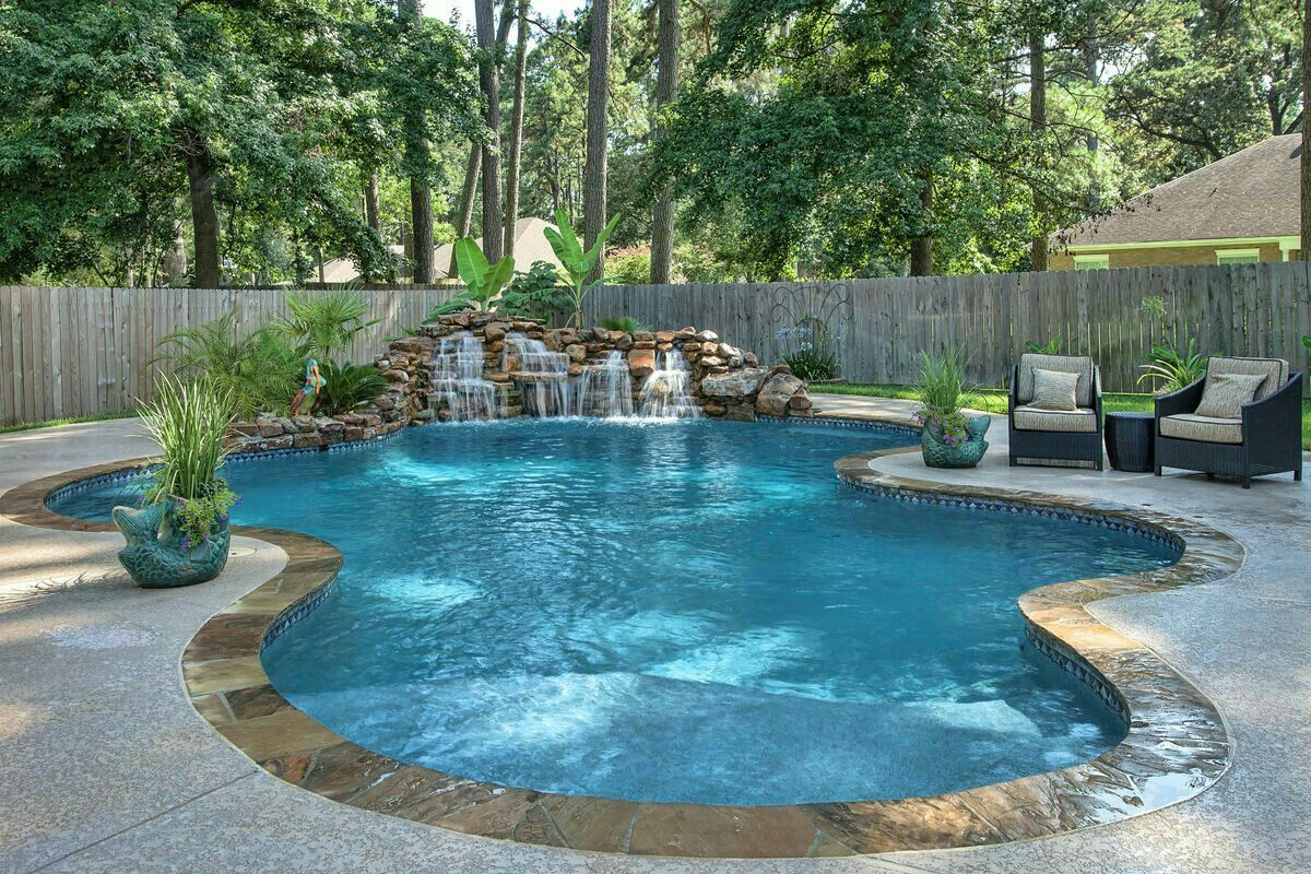 Pretty love the waterfall pool and outdoor kitchen in for Pool design tips