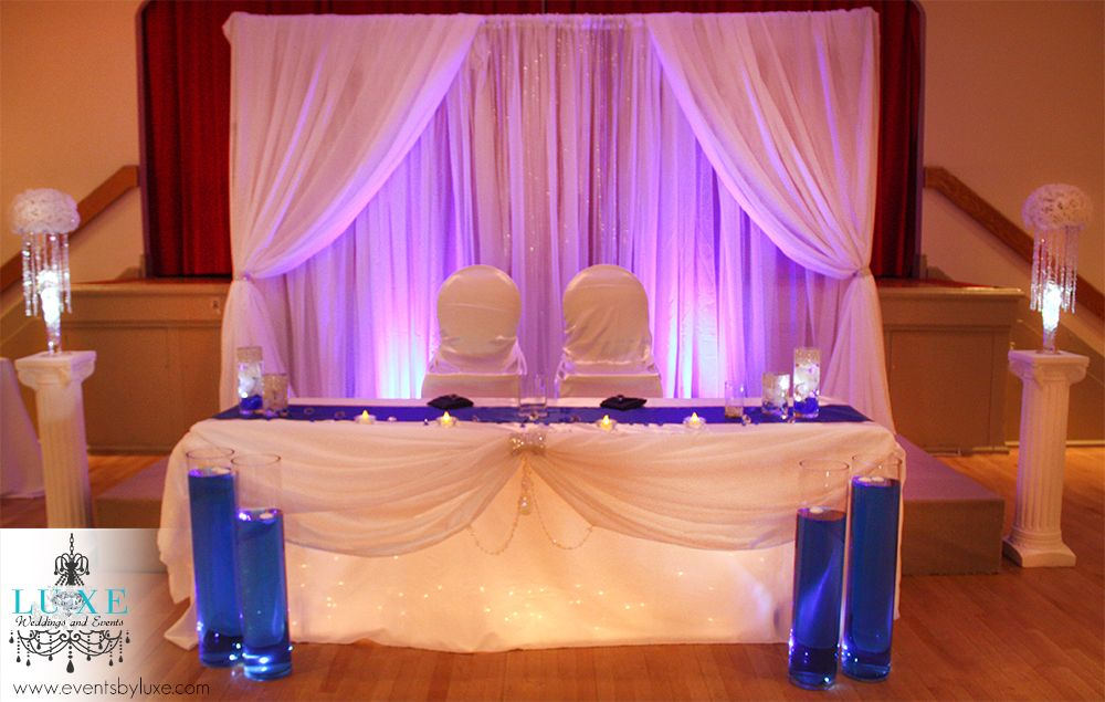 Royal blue white silver accents wedding decor at the for 25th wedding anniversary stage decoration
