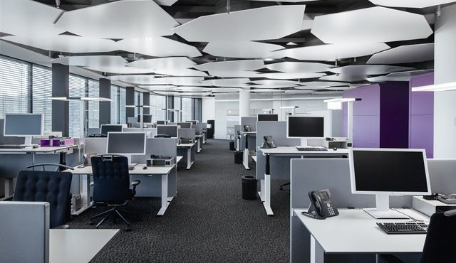 The hybrid cooing ceiling made of adjustable elements also improves the acoustics in the offices for the light concept zumtobel designed the free standing