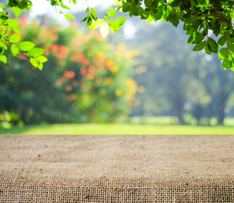 Empty Table Covered With Sackcloth Over Blurred Trees With Bokeh Background Pro Spon Sackcloth Blur Photo Background Background Images Bokeh Background