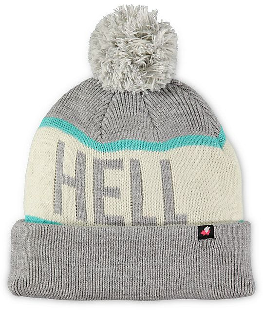 872348217ec You might want to shout it out loud when you put on this grey and mint pom  beanie from Glamour Kills.