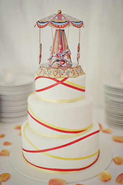 To fit in with our carnival theme we used a carousel toy as a cake topper. Vegan cake by Sticky Fingers Bakery in Washington DC