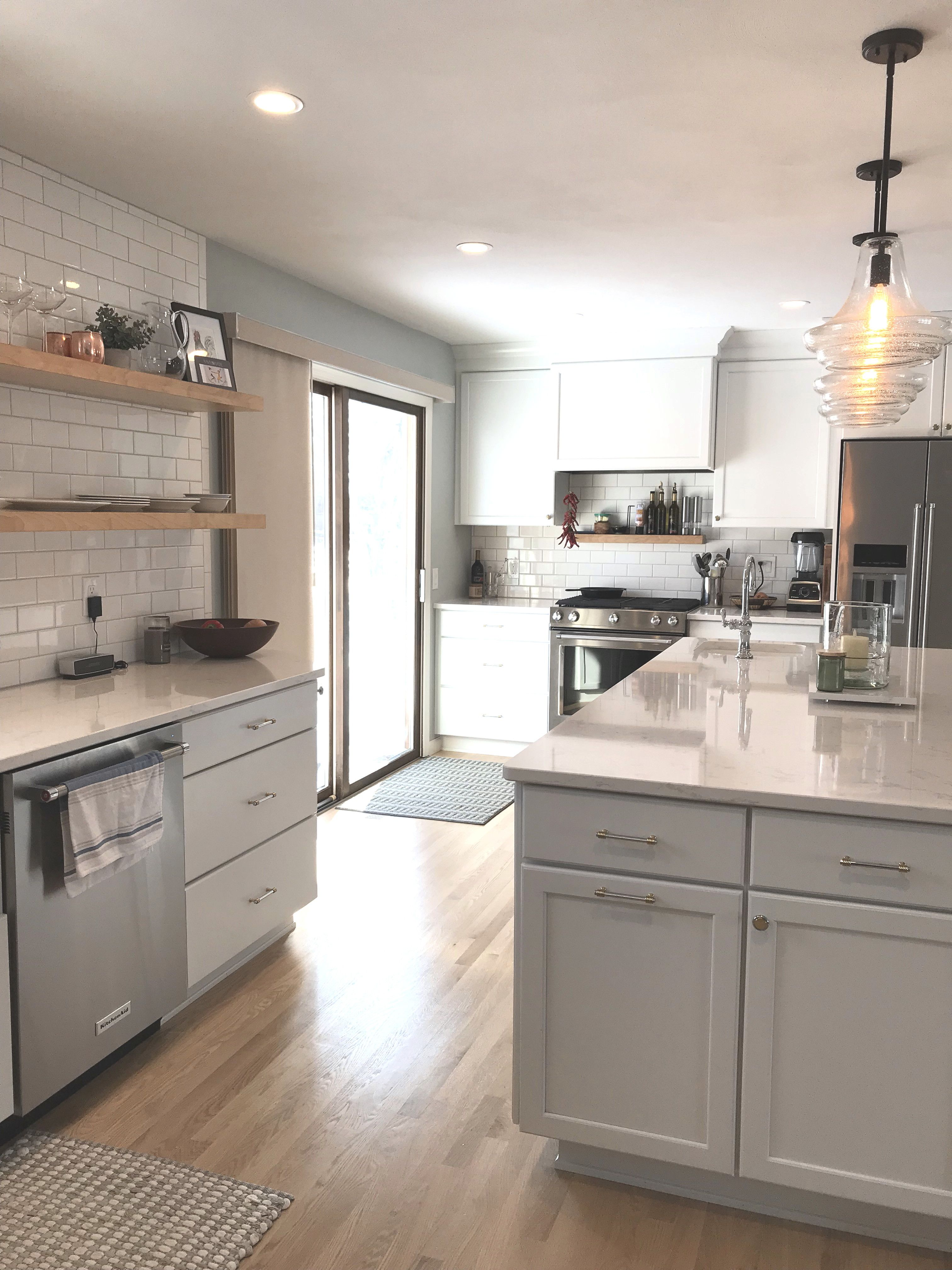 This Open Floor Plan Is Brightened Up With White Cabinets And