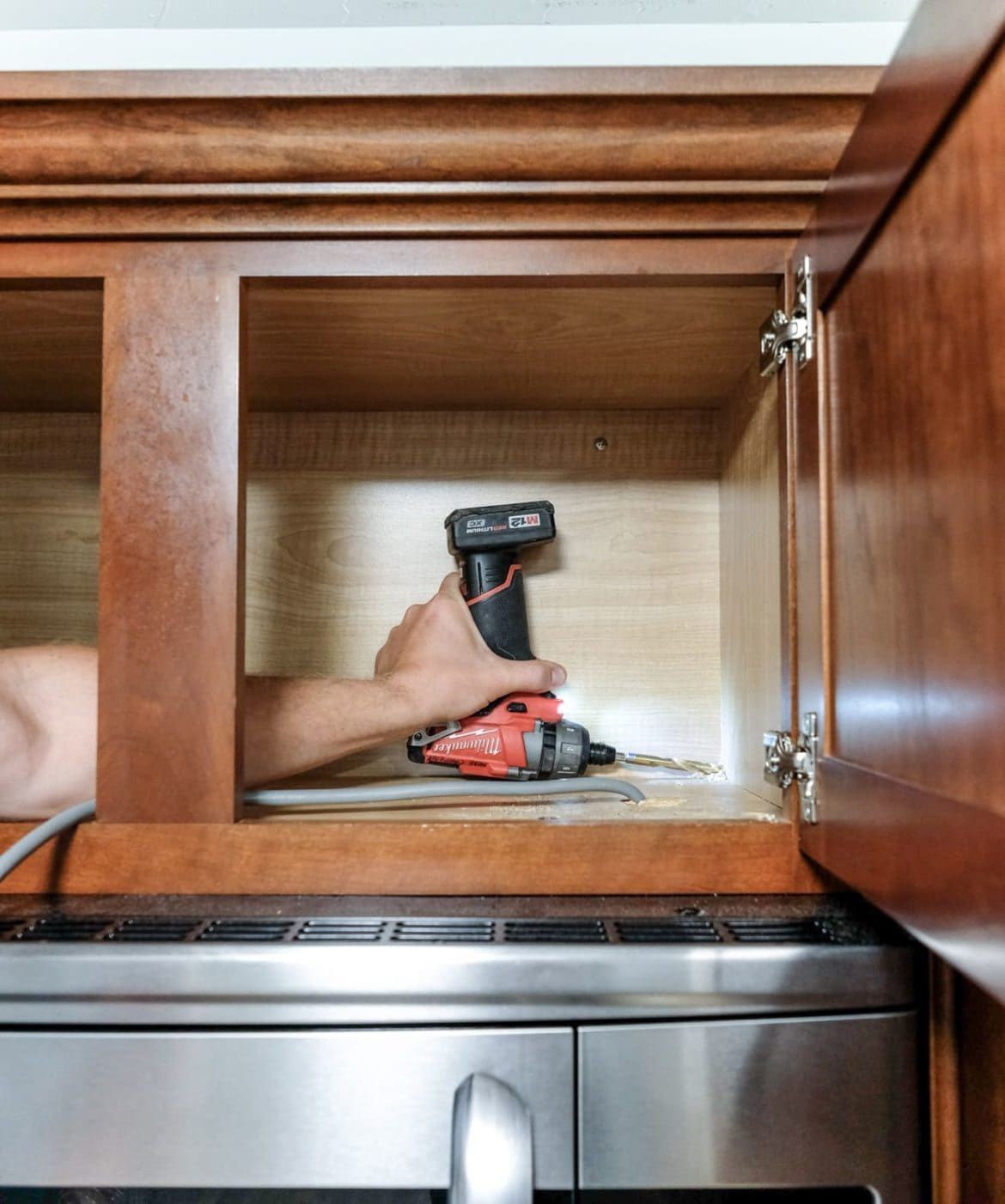 Looking for cabinet lighting ideas? This DIY under cabinet ...