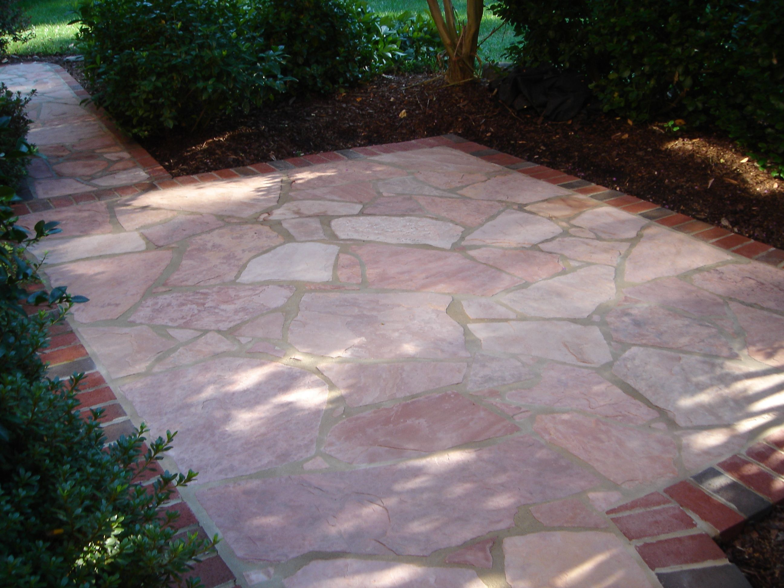 Brick and flagstone patio google search backyard for Pictures of stone patios