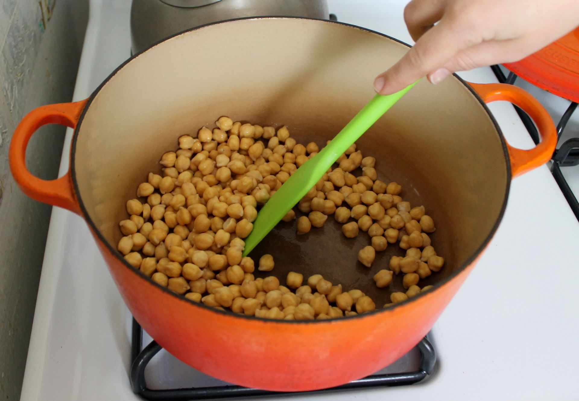 Cooking the chickpeas dry with a little baking soda speeds up ...