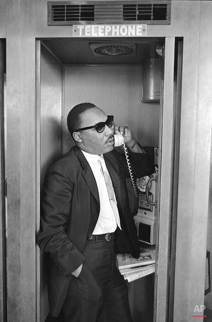 The Reverend Dr. Martin Luther King Jr. telephones aides during a stopover in Miami, Florida, August 14, 1965 [851x1294]