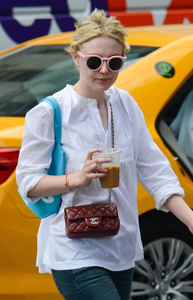 79d61c03372d Dakota Fanning with mini flap -50 Celebrities Carrying Chanel BaGS-7 ...