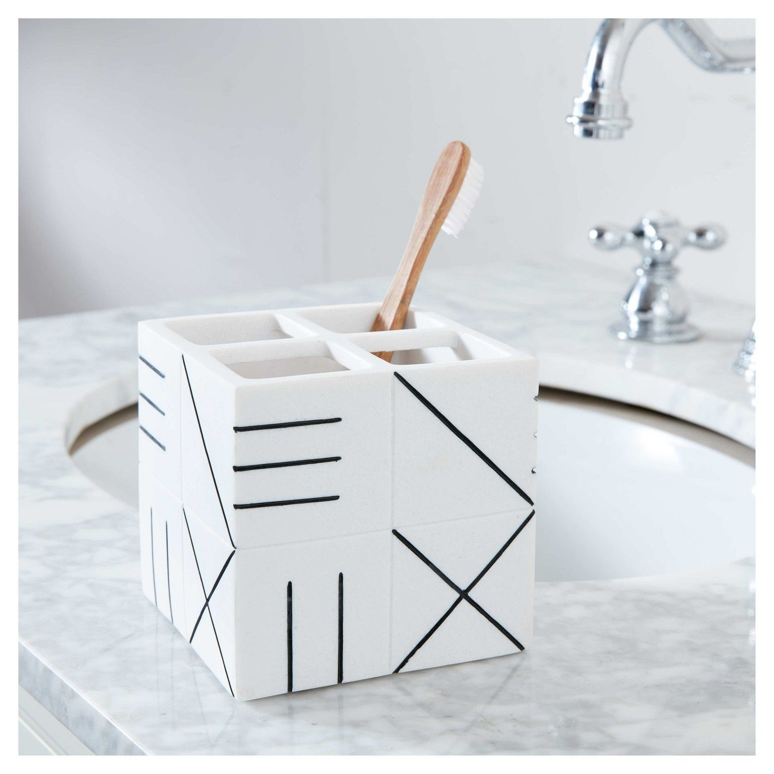 Bring function and style to your bathroom with this Nate Berkus Tiled Toothbrush Holder. The geometric line work and tiled pattern of this piece provides a nice modern accent to your bathroom
