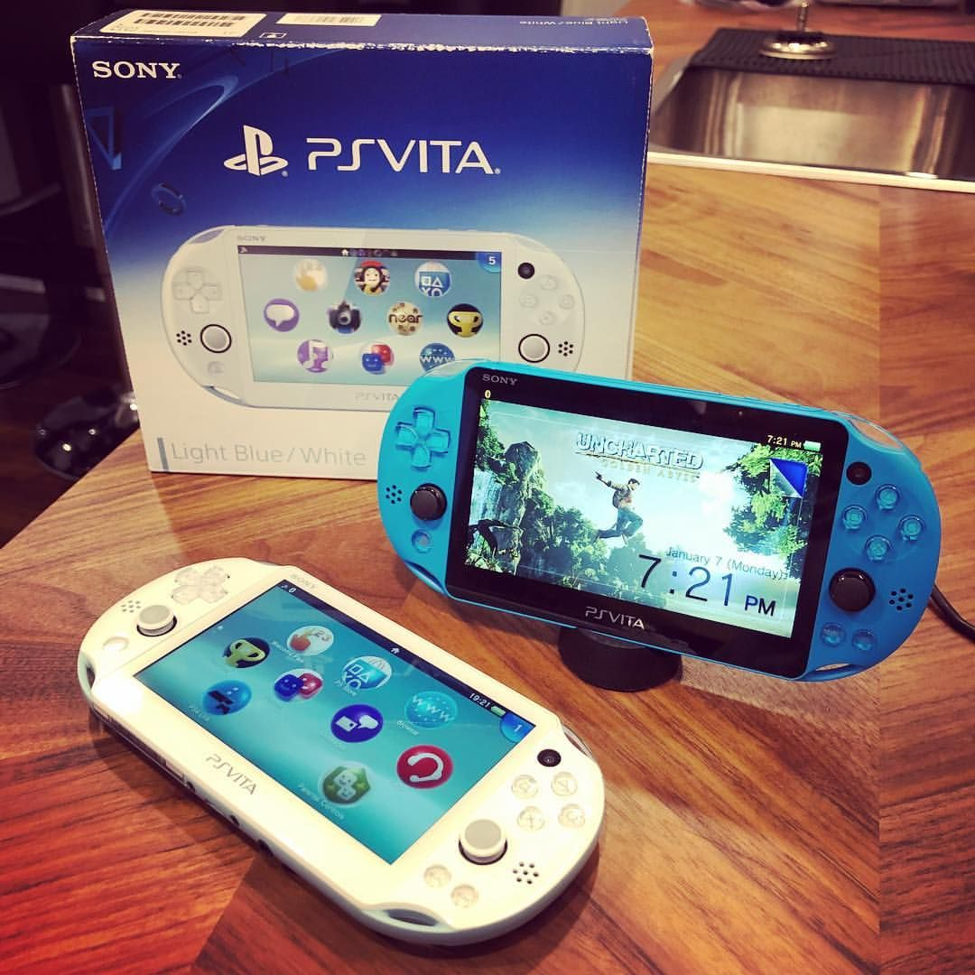 My Aqua Blue Psvita Welcomed A New Friend Into Our Home Its New Light Blue White Companion Survived Handheld Video Games Retro Video Games Playstation Games