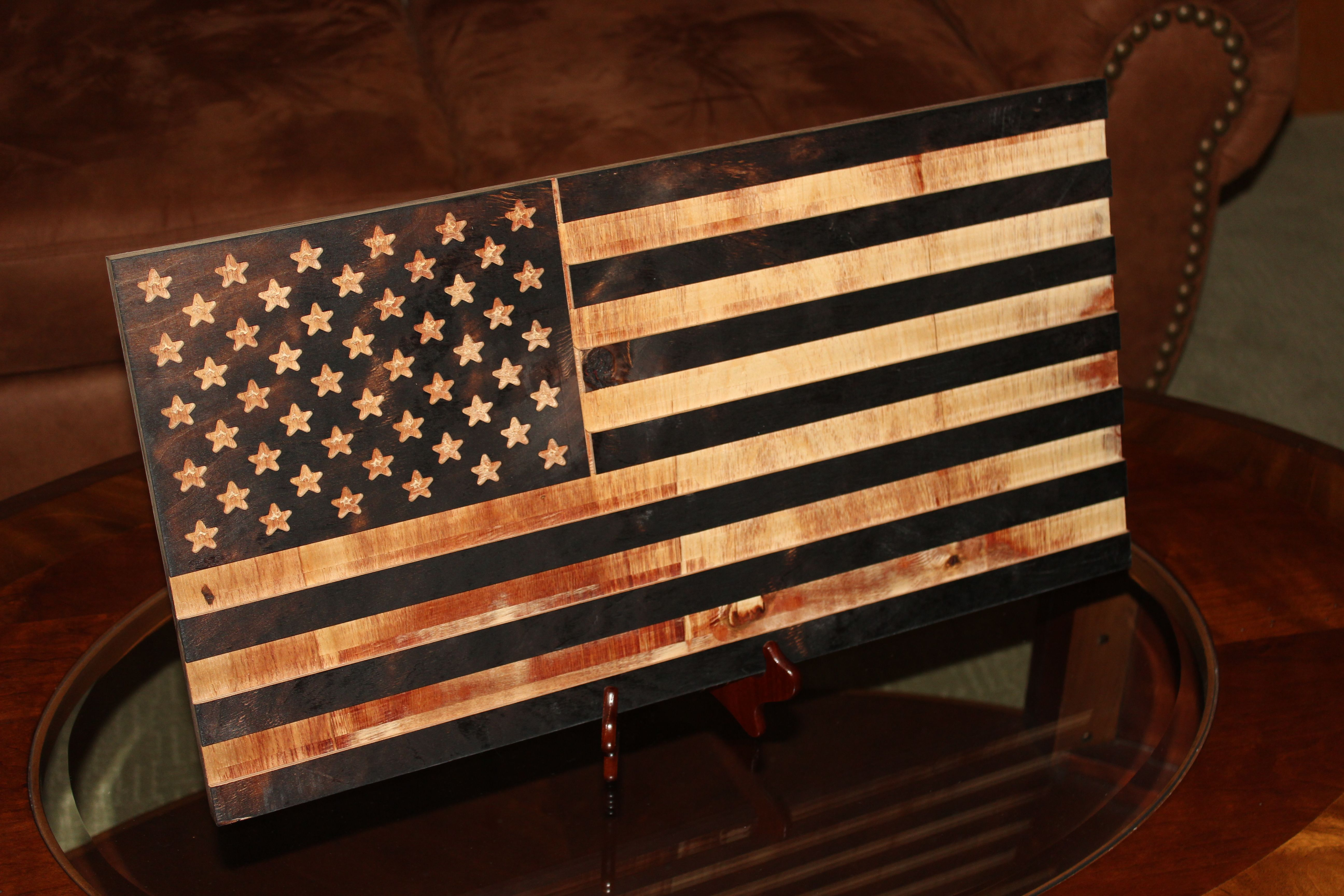 """A wooden flag made by The Monument Men, this flag is part of the """"From the Ashes"""" Collection"""