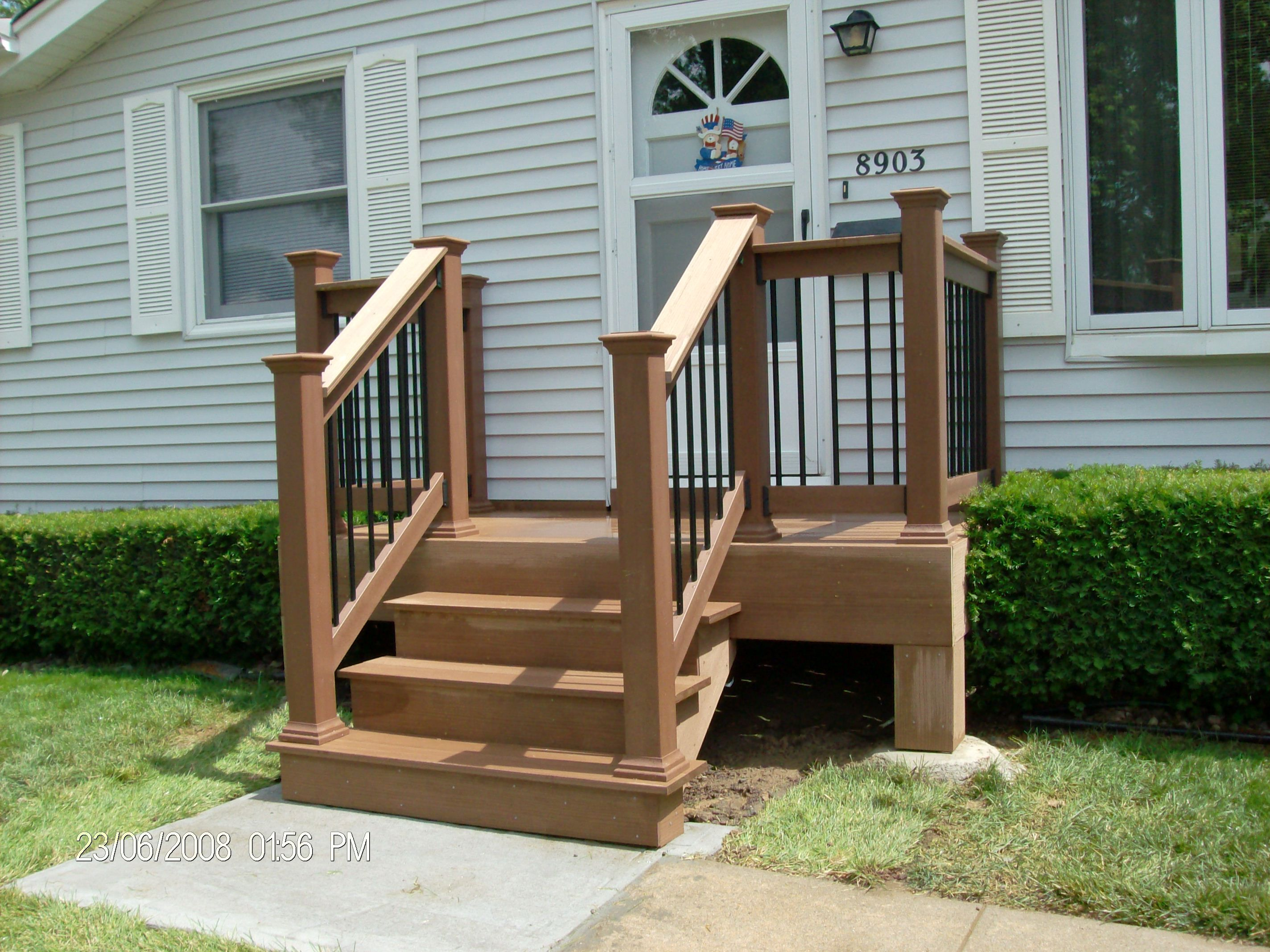 Small back deck with steps porch shown timbertech for Building a front porch deck