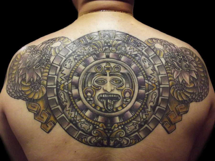 Aztec Mayan Calendar Tattoo Surrounded By Mayan Serpent Heads