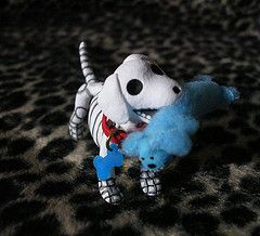 Ok, he even plays when he's dead. He has his little loofa toy. Omg so cute, I want him for our curio! =)